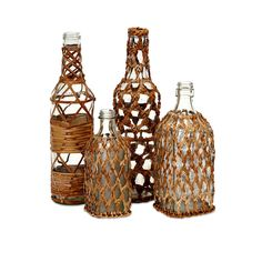 Add visual appeal to a shelf or jazz up a windowsill with this set of four Manitoba bottles from Imax. Decorative rattan in four different patterns adds texture and vintage style to sturdy glass bottles, creating an eye-catching look.
