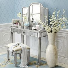 As glamorous as any star from Hollywood's Golden Era, yet as practical as we can make it, our Hayworth Vanity is all about functional fashion. Handcrafted, hand-painted and covered with bevel-cut mirrored glass, it can serve as dressing table or small desk. Add the folding mirror, available separately, and you have the perfect buddy picture. A Pier 1 Imports exclusive.
