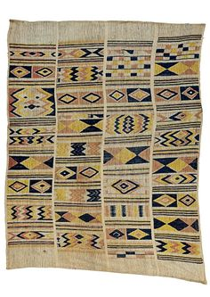 Africa | An Oshugbo or Ogboni society cloth from the Ijebu Yoruba people of south western Nigeria | Cotton/Silk; woven in four strips with geometric patterns in pink, yellow and indigo