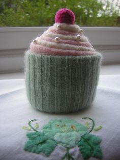 A cupcake pincushion made from an old jumper!
