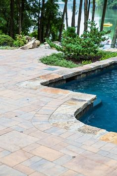 Looking for a pool patio like this? Create your own beautiful backyard pool patio with pavingstones from Cambridge Pavingstones with ArmorTec. Click the picture for more inspiration. Let's help you get started in 2018! Installation: Kodiak Landscaping