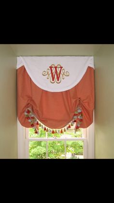 Monogrammed valance on a relaxed balloon shade. A Shade Better, Memphis, Tn