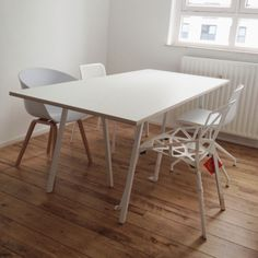The dining... Magis chair one, kartell white chair edition, hay loop table, hay wood/plastic cup chair