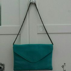 J. Crew teal envelope clutch Pre-owned   J. Crew teal envelope clutch. Can be use as a shoulder bag with the brass color chain or as a clutch.  100% leather. Good condition. Not tear or scratches. Clean interior. J. Crew Bags Clutches & Wristlets