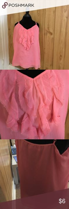 Sleeveless ruffle top Old Navy coral sleeveless top with ruffle detail down center. Has two layers but is still pretty sheer. Edges of ruffle detail have a silver shimmer and are unfinished, see picture. Tags removed but never worn, because it didn't fit. Old Navy Tops Blouses