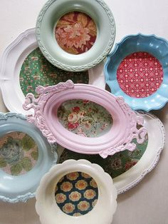 Vintage metal trays freshened up with paint and pretty paper...