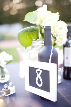 easy chalkboard seating numbers  Photography by marinkristine.com, Floral Design by stemsfloristvacaville1.com, Wedding Coordination by 2chicevents.com