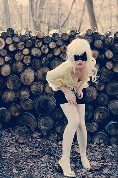 Lace blindfold? next to a pile of wood? cool pic but i think i might be missing something.