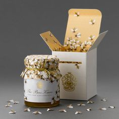 I think this honey packaging is amazing.  I wish I could find the product somewhere. The box is designed to look like a bee box.  Then, when you open the box, there are paper bees inside with the jar.