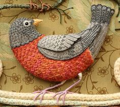 "Salley Mavor's robin from 3D fiber illustration, ""Birds of Beebe Woods."" Love all of the stitching all over the bird."