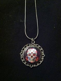 "Sugar skull pendant necklace On 16"" silver coloured necklace $10"