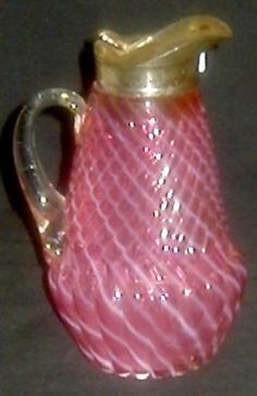 Cranberry Glass; Syrup Pitcher, Chrysanthemum Swirl, Opalescent.