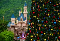At Hong Kong Disneyland, Main Street, U.S.A., is Christmas Town this time of the year and the celebration includes a wonderfully decorated tree in front of Sleeping Beauty Castle