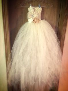 My flower girl dress DIY But with flowers at the bottom of the tulle