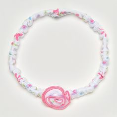 A lovely headband for baby girl by Kissy Kissy. Made from 100% Peruvian pima cotton for softness and comfort. With cute colourful prints of butterflies, flowers and hearts. It's perfect foreveryday wear. Complete the look with matching items from Kissy Kissy's Summer Cheerrange.