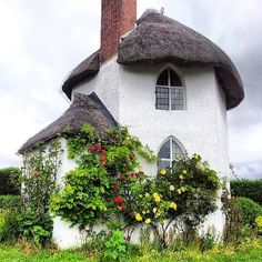 Quaint Storybook house with arched leaded windows and thatched roof Toll House. Storybook Homes, Storybook Cottage, Cute Cottage, Cottage Style, Irish Cottage, Toll House, Fairytale Cottage, Cottage Gardens, Thatched Roof