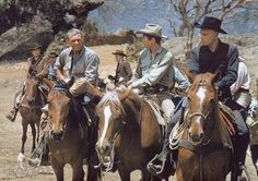 Still of James Coburn, Steve McQueen and Yul Brynner in The Magnificent Seven