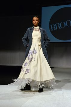 Silk taffeta, hand painted casual gown with feather trim.  Think mountain wedding, on trend coat to get you to the venue.  See more on The Knot at http://www.theknot.com/Vendors/Brooks-Ltd-Custom-Bridal-and-Mother-of-the-Bride-Gowns/Profile/BWP/020/825066/profile?sid=o1eKQrijDigr4QkHvkyCHA