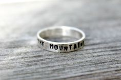 """The mountains are calling"" handmade ring, $36.89.  Scott, if you're trolling my boards, I want this one.  Size 7.  Thanks. ;)"