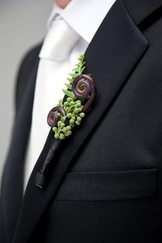 unique boutonniere, really neat I love it!