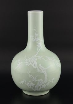 Chinese porcelain bottle vase, the pale celadon ground enamelled in white with two birds in a prunus - Current price: $303