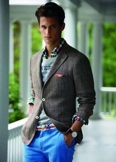 Cool outfit. This guy is really brave to wear sports vest on shirt and jacket. True sprezzatura: http://www.moderngentlemanmagazine.com/the-art-of-sprezzatura-looking-good-without-trying-to-hard/