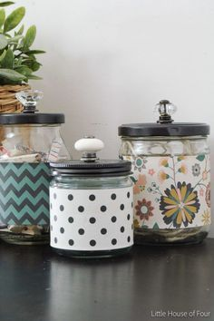 Pickle Jar to Apothecary Jars Tutorial: Paint the lids, then add a cute drawer pull and some patterned fabric, and you've got yourself a vintage-looking apothecary jar for storing bathroom essentials.