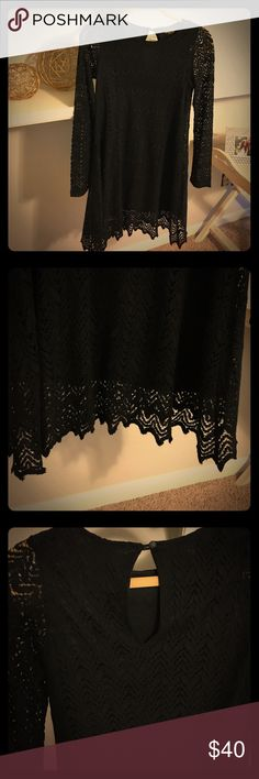 """Long Sleeve Short Black Dress Fabulous long sleeve short black dress.  Fully lined, the only true """"see thru"""" part of the dress are the sleeves.  Size small.  Great dress because it can be worn to many different types of events both day/night. Dress it up or down, can be worn year-round.  As with most of my daughter's clothes......only worn one time! AUDREY Dresses Long Sleeve"""