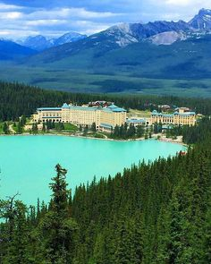 Surrounded By Soaring Mountain Peaks The Majestic Victoriaglacier And A Glistening Emerald Lake Iconic Fairmont Cau Lakelouise Hotel Is Located