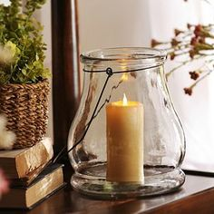 Clear glass lantern from Kirkland's. Just bought this, and I love it already. Can't wait I decorate it up and use it.
