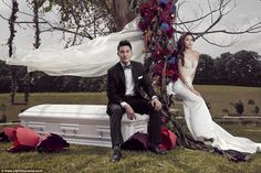 Undertaker couple pose for pre-wedding shoots with a coffin to honor their profession --                  With Ms Tay in a wedding dress and her fiance in a tuxedo, the couple could look like any other posing for wedding pictures - except for the gleaming white casket