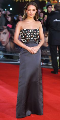 Alicia Vikander continued her LV streak and brought another one of her on-point looks to the UK premiere of The Danish Girl in a slinky strapless Louis Vuitton creation with an embellished bodice. Delicate drop earrings and a cocktail ring served as the finishing touches.