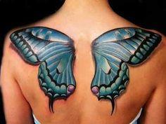 Lovely blue butterfly wings tattooed on back.