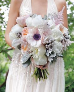 This dreamy clutch of anemones, astilbe, Juliet garden roses, peonies, succulents, brunia, and dusty miller in watercolor shades stole the scene at a real wedding in Wimberley, Texas.