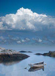 Seafarers Vision of an Anchored Wooden Boat in the Calm of Peggys Cove Harbor in Nova Scotia Canada - A Fine Art Boat Seascape Photograph