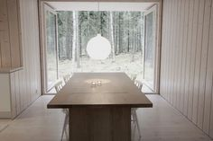 The Louis Poulsen Satellite lamp ($715) in the dining area hangs over a birch table from the Finnish maker Nikari (a prototype bought for $1,000) and wooden chairs salvaged from the trash.