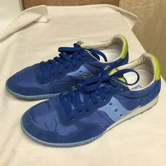 Saucony Women's Sneakers sz9 Worn once, very very comfortable and lite. No tear and no stains and comes in a pet/smoke free home sz9. Made of fabric and leather colors blue and lime green. All lettering are still all visible. Thanks for looking. Saucony Shoes Athletic Shoes