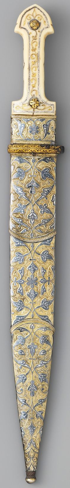 Caucasian qama / kindjal ), 1856–57, 1861, steel, bone, silver, gold, shark skin, ivory, niello, iron, L. with sheath 19 1/4 in. (48.9 cm); L. without sheath 19 1/16 in. (48.4 cm); L. of blade 14 3/4 in. Wt. 12.8 oz. (362.9 g), Met Museum.