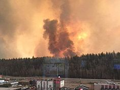 Araging wildfire, whipped by strong winds from a cold front that arrived Wednesday, hasdestroyed 1,600 structures in theCanadianoil sands city of Fort McMurray and driven outalmost the entire population of 83,000 people.