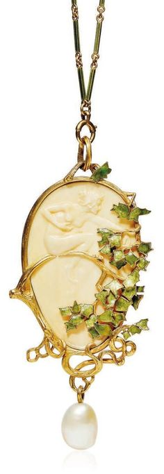 RENÉ LALIQUE - AN ART NOUVEAU GALALITH, ENAMEL AND PEARL PENDENT NECKLACE, 1899-1902. The oval galalith panel depicting a nymph sitting on a textured gold branch, the surround designed as a golden scrolling tree trunk, applied with green enamel ivy leaves, suspending a pearl, to the green enamel baton-shaped chain, with French assay marks for gold, signed Lalique.