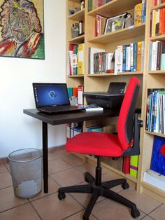 billy_desk_01  This desk sits on the shelf and can be removed when not in use - maybe on the end bookshelf for the laptop?