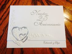 Front cover of wedding invitation in silver ink