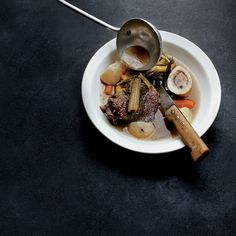 For this dish, David Duband braises two cuts of beef—shank and rump roast—with marrow bones and then separately cooks leeks and carrots with more ...
