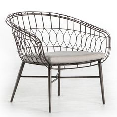 """Reminiscent of vintage garden furnishings, the Brittany chair offers inspired design to covered outdoor spaces. This metal accent features a curving silhouette in a sleek silver finish, the open woven design exuding light and airy style. A loose cushion offers comfort and versatility in fade-resistant fabric. 28.25""""W x 27.25""""D x 27.25""""H. Iron, 100% acrylic UV-resistant Sunbrella fabric."""