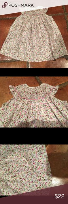 Barney's Smocked Dress Barneys New York smocked Floral Dress. Perfect condition, smoke and pet free home. Tag reads 6 mo. Barneys New York Dresses Casual