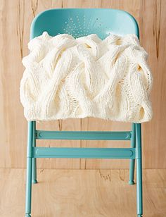 This cable knit blanket is a super cozy classic that you'll love to curl up with. (Yarnspirations)