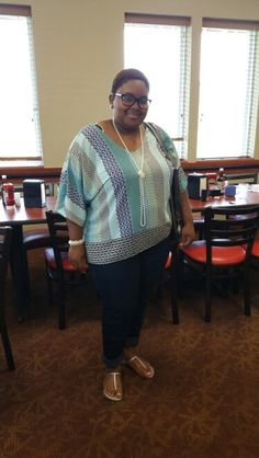 Silk top with jeans and silver sandals  Jewelry: Pearls