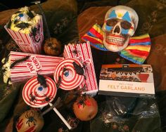 I like the eyeball lollipops for decoration or to serve. I also like the clowns bow tie & paint job. I may do a display with several clown skulls on cake stands in varied heights.