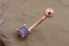 Rose gold belly button ring with a tanzanite crystal belly ring. The tanzanite crystal on the belly button ring is in diameter. The belly rings 14 gauge and long, and is made of surgical steel plated with rose gold. Gold Belly Button Rings, Belly Button Piercing Jewelry, Ear Piercings Cartilage, Piercing Ring, Belly Rings, Piercing Ideas, Piercing Types, Tongue Piercings, Nose Rings