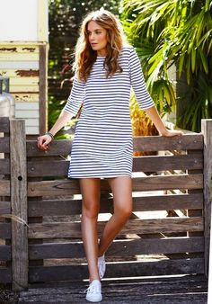 Sneakers with dresses tips. summer striped dress and white sneakers